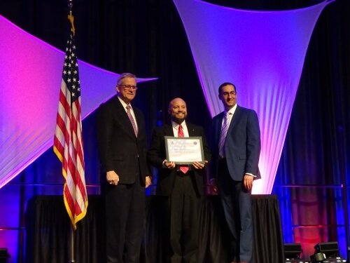 Dr. Earl Catagnus Jr. accepts the CAE2Y designation on behalf of Valley Forge Military College.