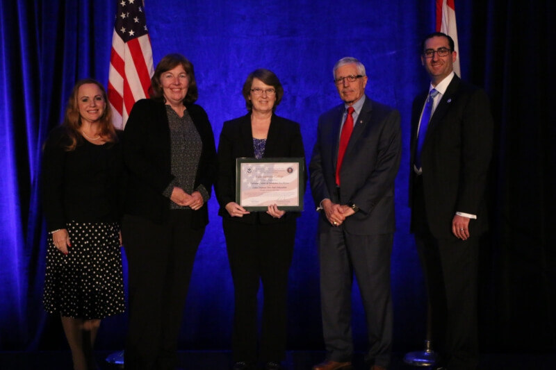 Centers of Academic Excellence (CAE) Designation Ceremony at the NICE Conference & Expo November 1-2, 2016 in Kansas City, MO. From left to right: Diane M. Janosek, Deputy Commandant, National Cryptologic School, National Security Agency; Corrinne Sande, C5 Co-PI in charge of the CAE2Y Mentor Program; Vickie McLain, Computer Information Systems faculty member at Lake Superior College; Stephen Miller, Associate Professor/Director Cybersecurity Center of Excellence at Eastern New Mexico University—Ruidoso and C5 mentor; Daniel Stein, Cybersecurity Education and Awareness Branch, Department of Homeland Security.